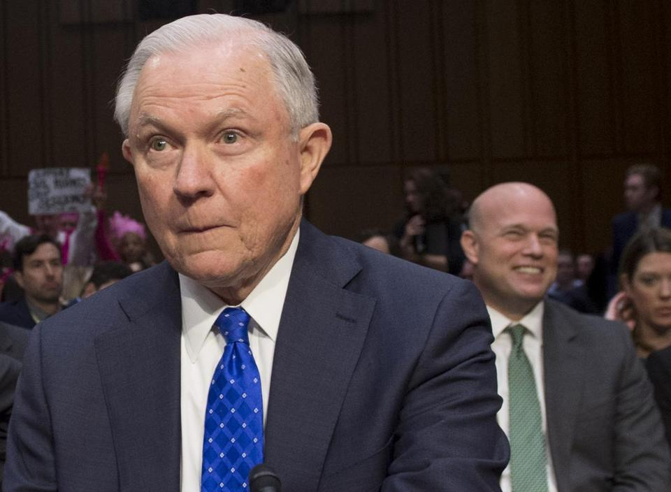 (FILES) In this file photo taken on October 18, 2017 US Attorney General Jeff Sessions arrives to testify as as Matthew G. Whitaker (R), Chief of Staff to Attorney General Jeff Sessions smiles during a Senate Judiciary Committee hearing on Capitol Hill in Washington, DC. - US attorney general Jeff Sessions said he is resigning at Trump's request on November 7, 2018. Matthew G. Whitaker will be the new Acting Attorney General. (Photo by Saul LOEB / AFP)SAUL LOEB/AFP/Getty Images
