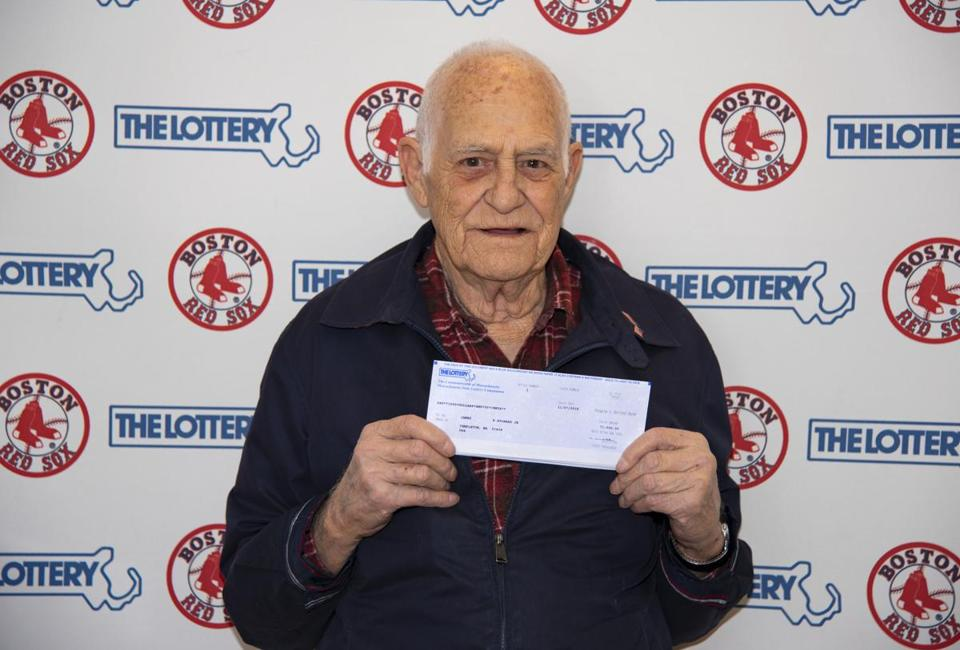 Jim Aylward with his Massachusetts State Lottery check.