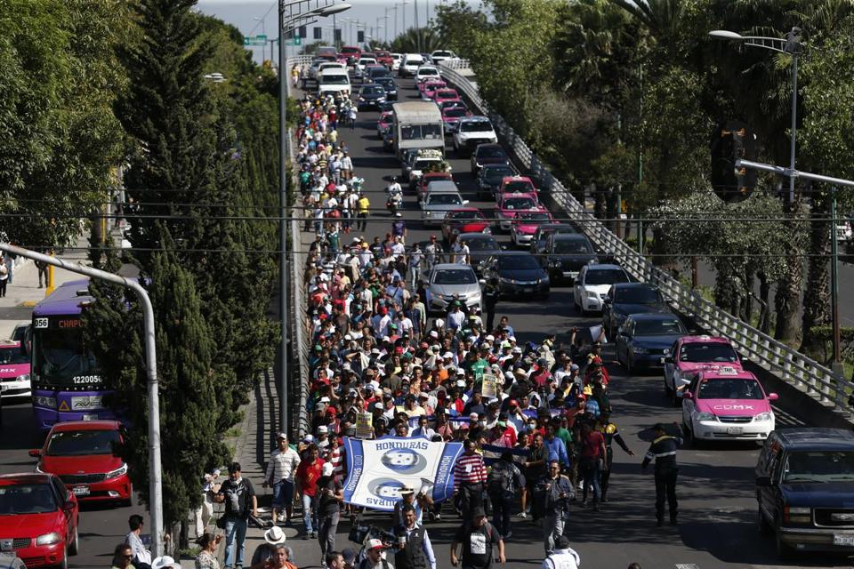 Central American migrants marched Thursday to the United Nations office in Mexico City to demand buses to the US border.