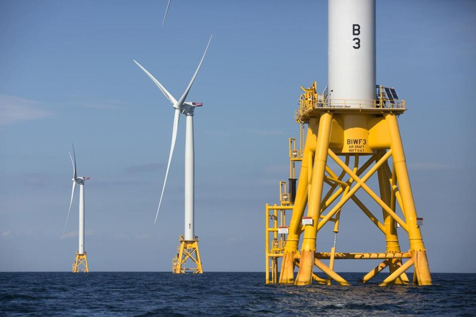 In this Aug. 15, 2016 , three of Deepwater Wind's turbines stand in the water off Block Island, R.I. Providence, R.I.,-based Deepwater Wind announced Monday, Oct. 8, 2018, that the Danish offshore wind company Orsted has entered into an agreement to buy it. The agreement must be approved by federal regulators.