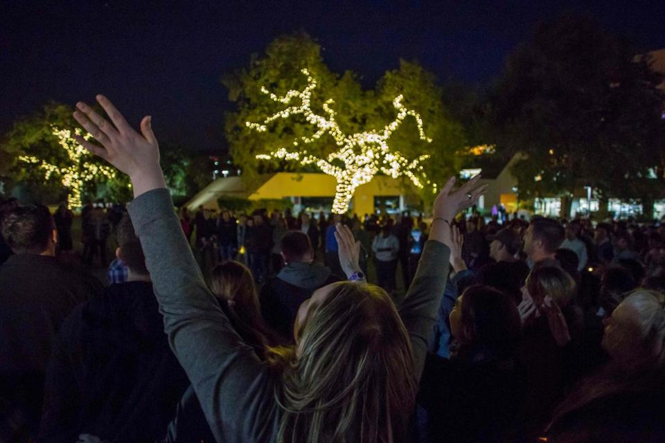 A woman raised her hands during a vigil to pay tribute to the victims of the shooting in Thousand Oaks, California.