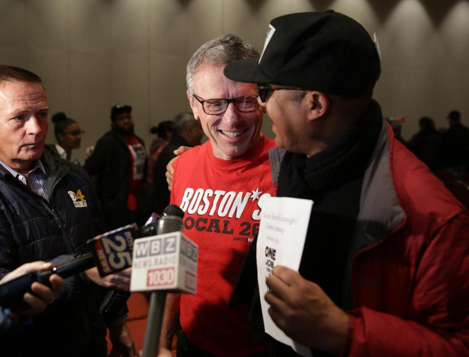 Brian Lang, left, president of Unite Here Local 26 in Boston, spoke at a news conference last month about the settlement of the strike against Marriott Hotels in Boston.