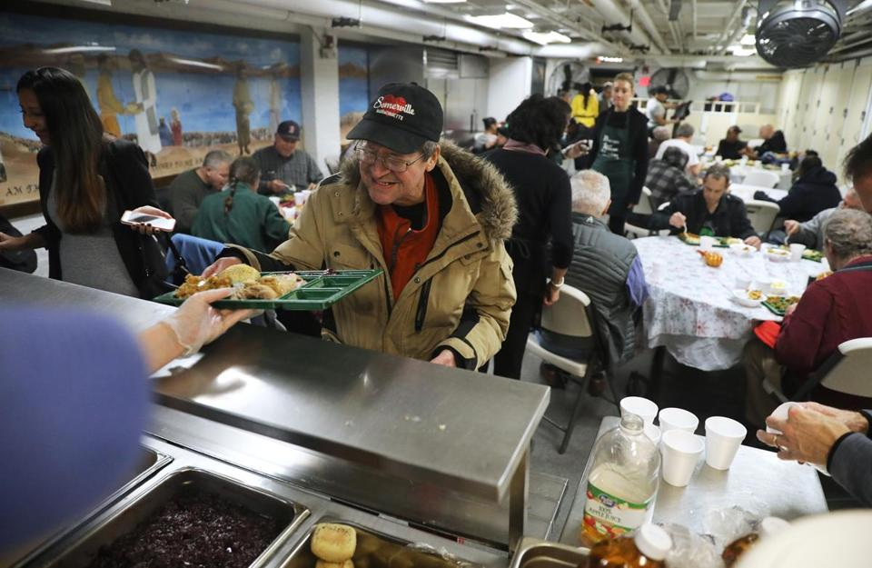 Johnny Mason was served a hot Thanksgiving meal Sunday at the Boston Rescue Mission's annual Day of Thanks.