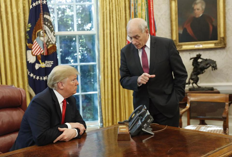 President Donald Trump listens to White House Chief of Staff John Kelly right following Trump's meeting to discuss potential damage from Hurricane Michael in the Oval Office of the White House in Washington Wednesday Oct. 10 2018. (AP