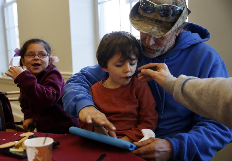Ryker (center), 3, and Annalyse Rivera, 6, of South Lawrence ate with relatives Joe Rivera and Rosalie Davis in Andover.