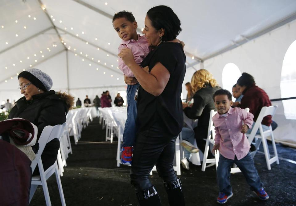 Evelyn Corona of South Lawrence (center) danced with Jose, 3, at one of the heated tents set up at South Common Park in Lawrence, where a makeshift trailer encampment has been set up for people unable to stay in their homes.