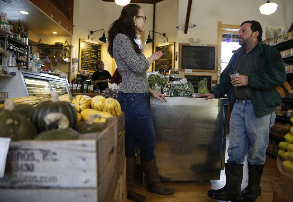 Hillary Leicher, a manager at Chef's Market, and egg farmer Chris Recchia discuss law enforcement in Randolph, Vt., which is now covered by the Orange County sheriff's office.