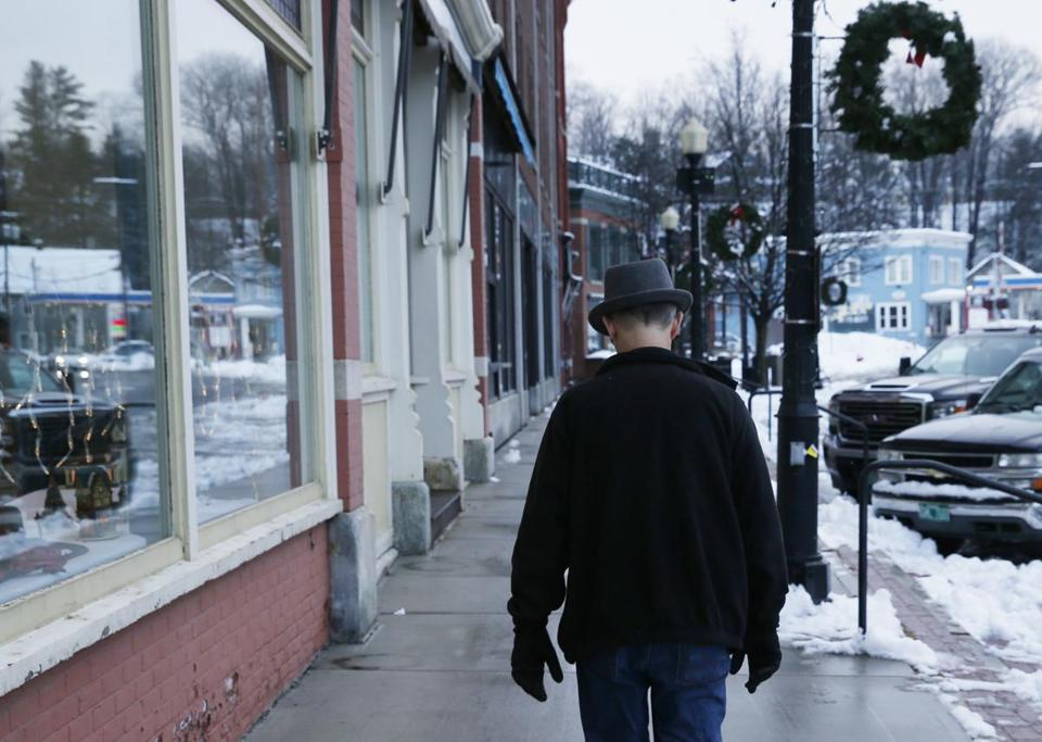 A man walked past shops in Randolph.