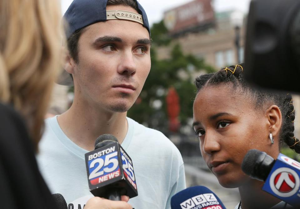 Worcester, MA - 8/23/18 - David Hogg (cq) and Vikiana Petit-Homme (cq) (Boston) speak to the media before the walk. Students and adult volunteers stage a short rally and then start their 50-mile walk from Worcester to Springfield, calling for gun-violence prevention. Photo by Pat Greenhouse/Globe Staff Topic: 24guns Reporter: J.D. Capelouto
