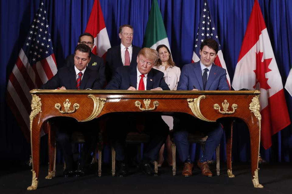 Donald Trump signs USMCA with Mexico and Canada at G-20