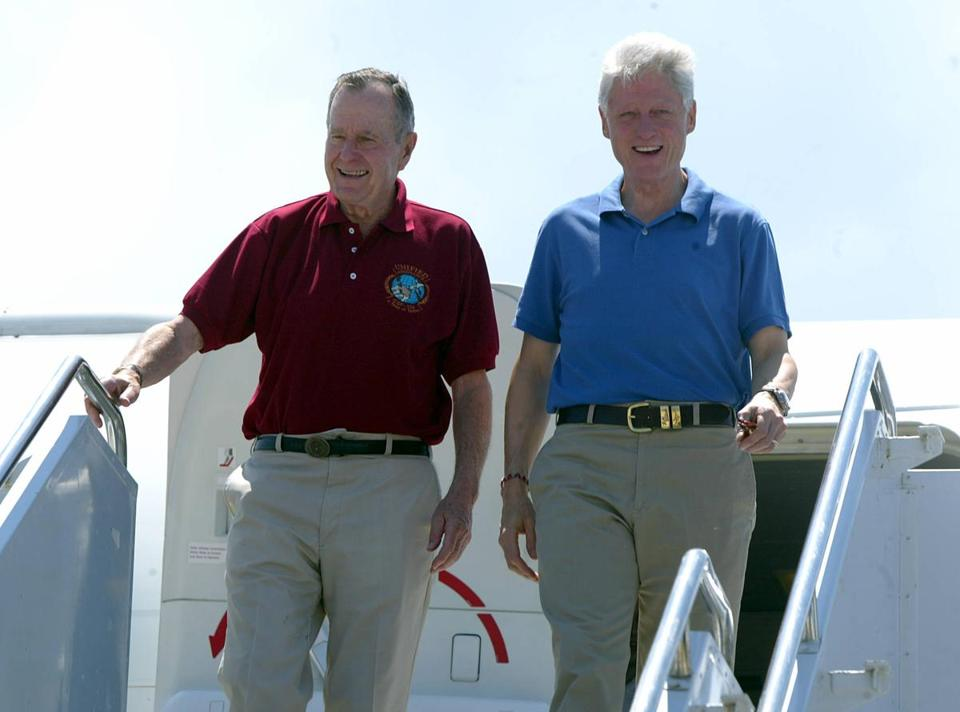 (FILES) In this file photo taken on February 18, 2005 US former presidents George Bush Senior (L) and Bill Clinton arrives in Phuket, south Thailand. - George H.W. Bush -- the upper-crust war hero-turned-oilman and diplomat who steered America through the end of the Cold War as president and led a political dynasty that saw his son win the White House -- died Friday. He was 94. (Photo by Roslan RAHMAN / AFP)ROSLAN RAHMAN/AFP/Getty Images