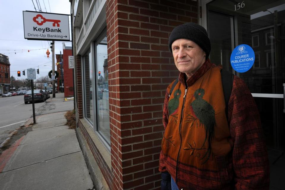 Belfast, ME - 12/01/2018 Lawrence Reichard is a columnist who was fired from the Republican Journal in Belfast, Maine for his columns criticizing the Nordic Aquafarms project. He is outside the newspaper offices in Belfast. Nordic Aquafarms, a Norwegian company has proposed building the largest indoor salmon aquafarm in the world in Belfast. While it would bring jobs and increase tax revenue, residents are concerned about a massive amount of polluted water flowing into Penobscot Bay. Fred J. Field for the Boston Globe Story by David Abel