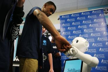 Jaheim Boles, 15, a student at English High School in Jamaica Plain, greeted the robot introduced to aid in computer programming.