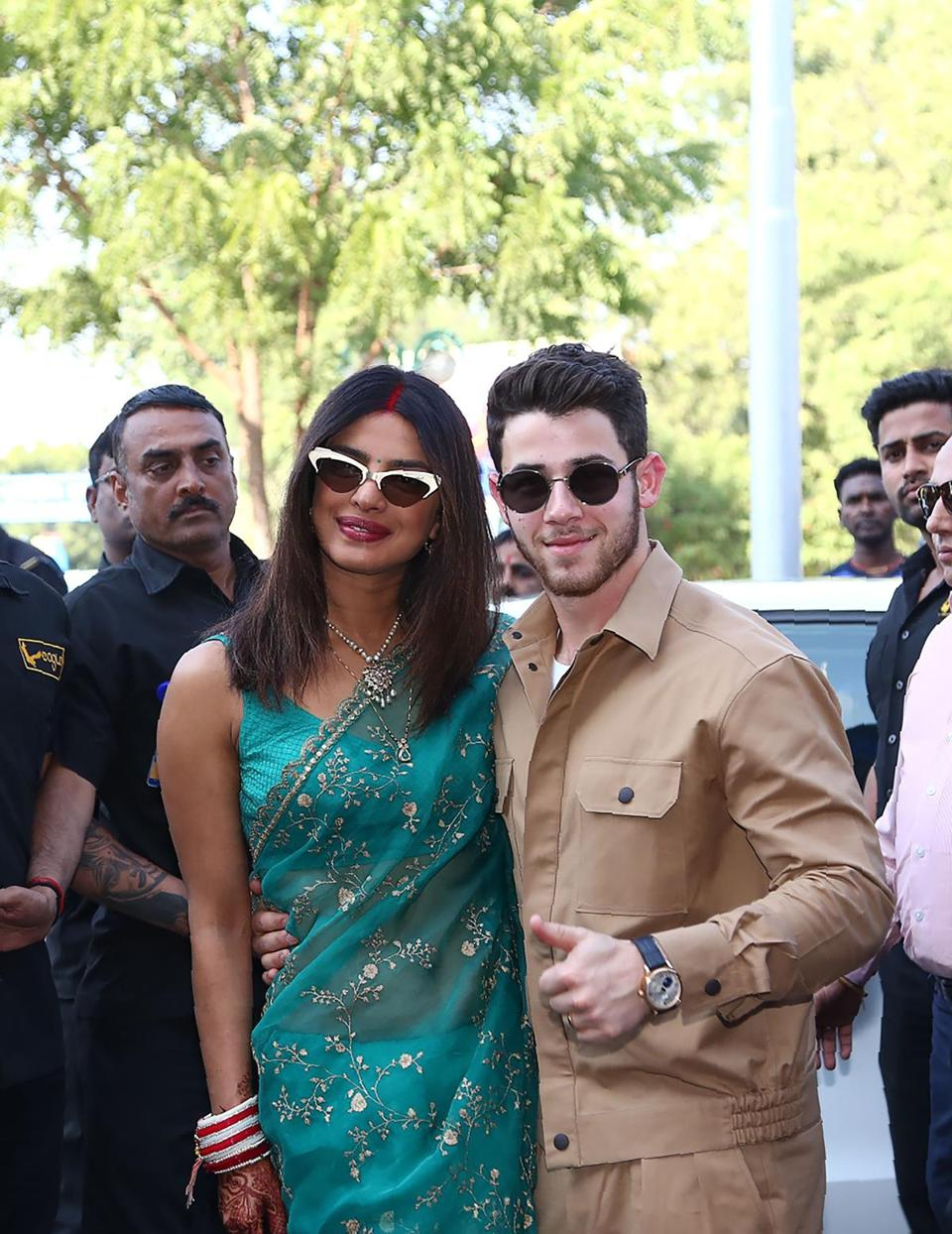 The couple posed for a photograph as they leave after their wedding ceremony in Jodhpur on Dec. 3.