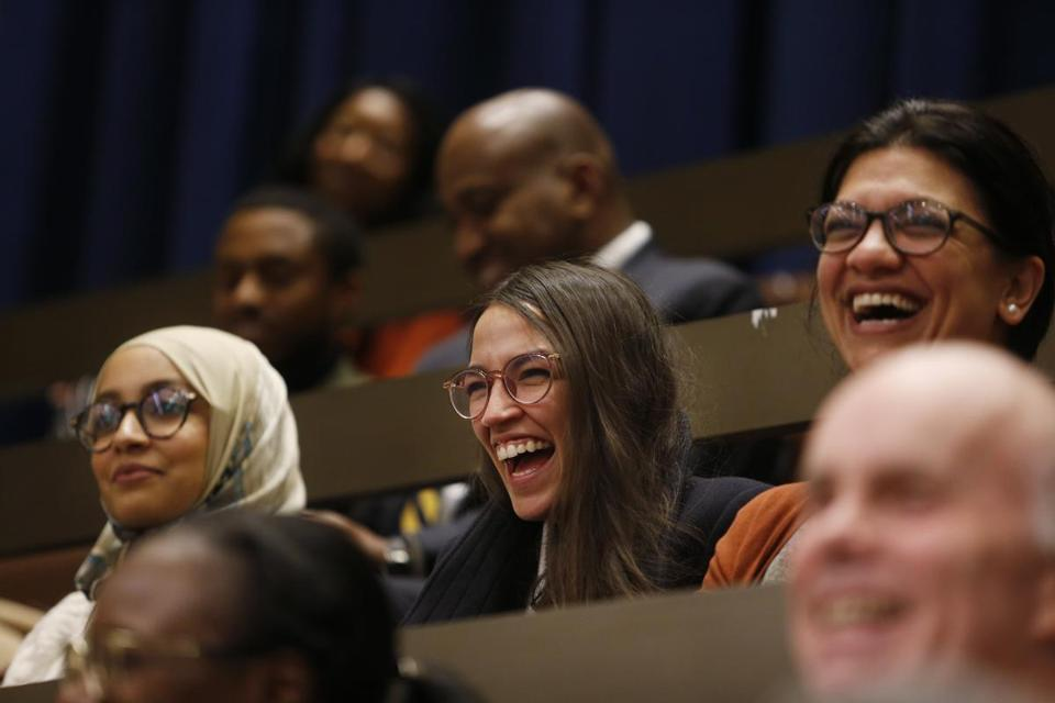 Boston, MA, 12/5/2018 -- Fellow congresswomen-elect Alexandria Ocasio-Cortez (C) and Rashida Tlaib (R) laughed as other City Councilors referenced them in their farewell speech to Ayanna Pressley at City Hall. (Jessica Rinaldi/Globe Staff) Topic: 06ayanna Reporter: