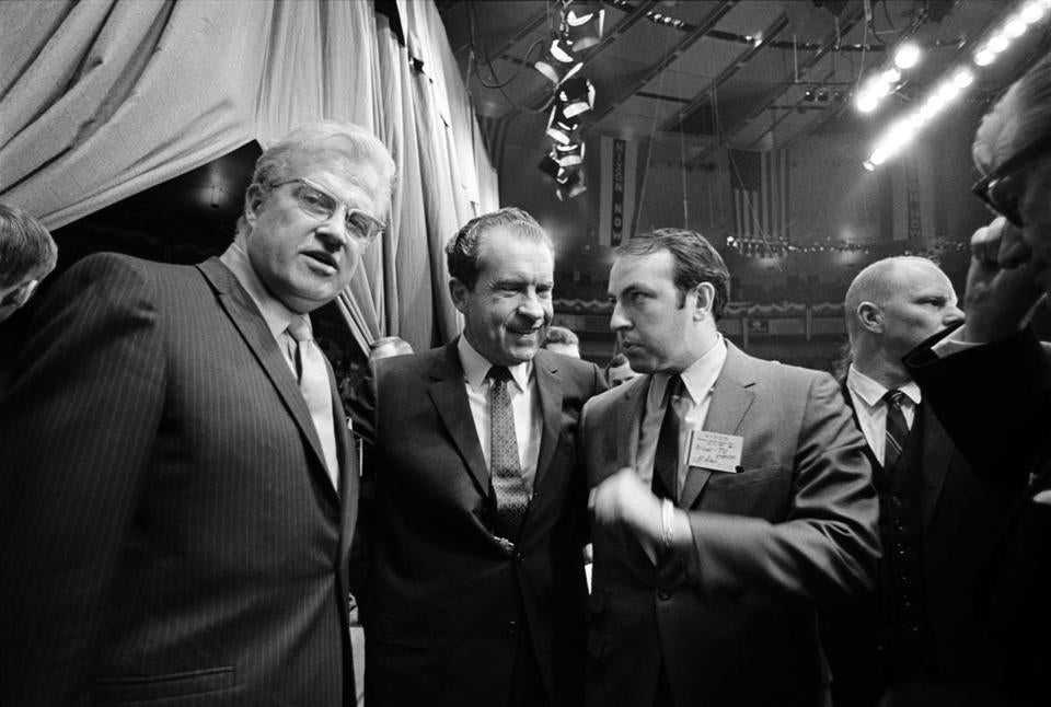 "Roger Ailes (center right) with Richard Nixon in 1968 in a scene from ""Divide and Conquer: The Story of Roger Ailes."""