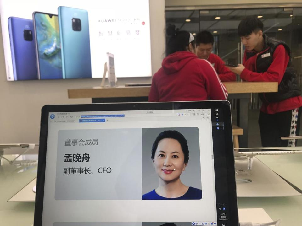 A profile of Huawei's chief financial officer Meng Wanzhou is displayed on a Huawei computer at a Huawei store in Beijing, China, Thursday, Dec. 6, 2018. Canadian authorities said Wednesday that they have arrested Meng for possible extradition to the United States. (AP Photo/Ng Han Guan)