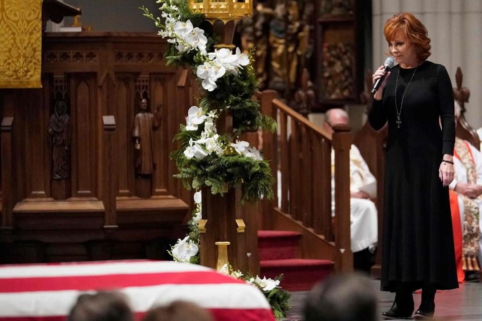 "Reba McEntire sings ""The Lord's Prayer"" during a funeral service for former US President George H.W. Bush at St. Martin's Episcopal Church, on December 6, 2018, in Houston. (Photo by David J. Phillip / POOL / AFP)DAVID J. PHILLIP/AFP/Getty Images"