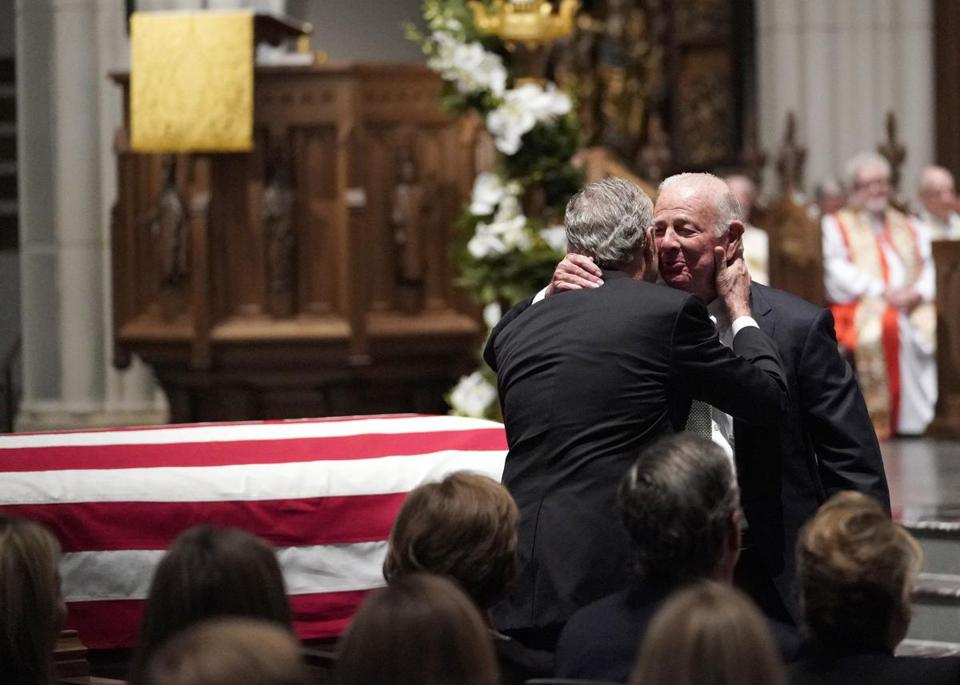 Former President George W. Bush embraces former Secretary of State James Baker, right, after he gave a eulogy during the funeral for former President George H.W. Bush at St. Martin's Episcopal Church, Thursday, Dec. 6, 2018, in Houston. (AP Photo/David J. Phillip, Pool)