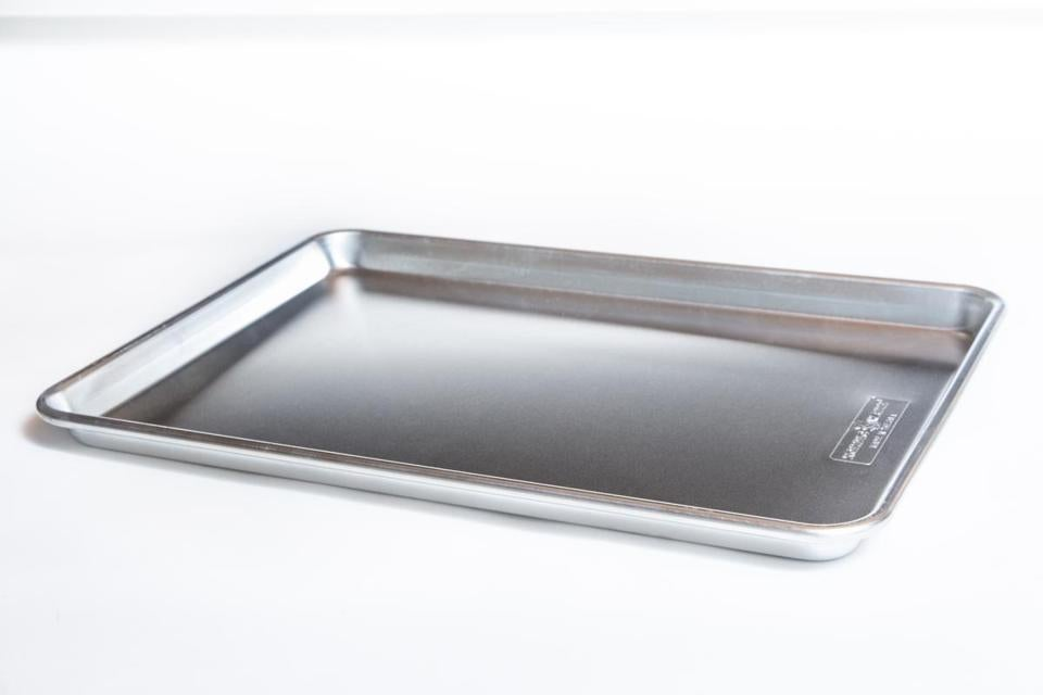 Most commercial-quality half-sheet pans, typically sold as 18-by-13-inch  pans, are actually 17¾ by 12¾ inches (interior 16¾ by 11¾) and 1 inch deep. Worry less about exact dimensions and more about finding a sturdy,  heavy-duty pan that won't warp over time.