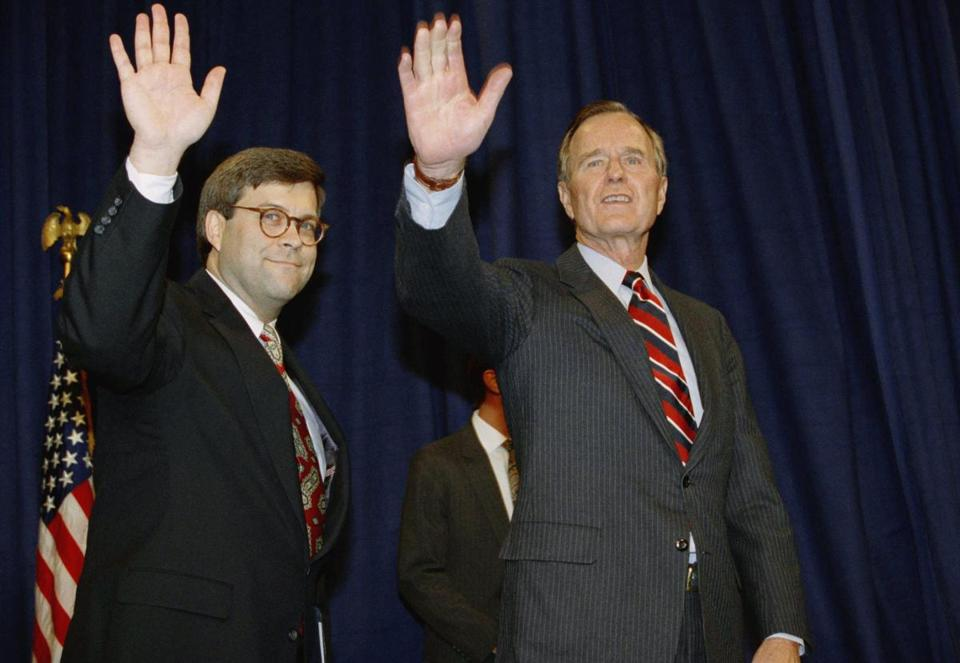 President George H.W. Bush and William Barr wave after Barr was sworn in as Attorney General in 1991