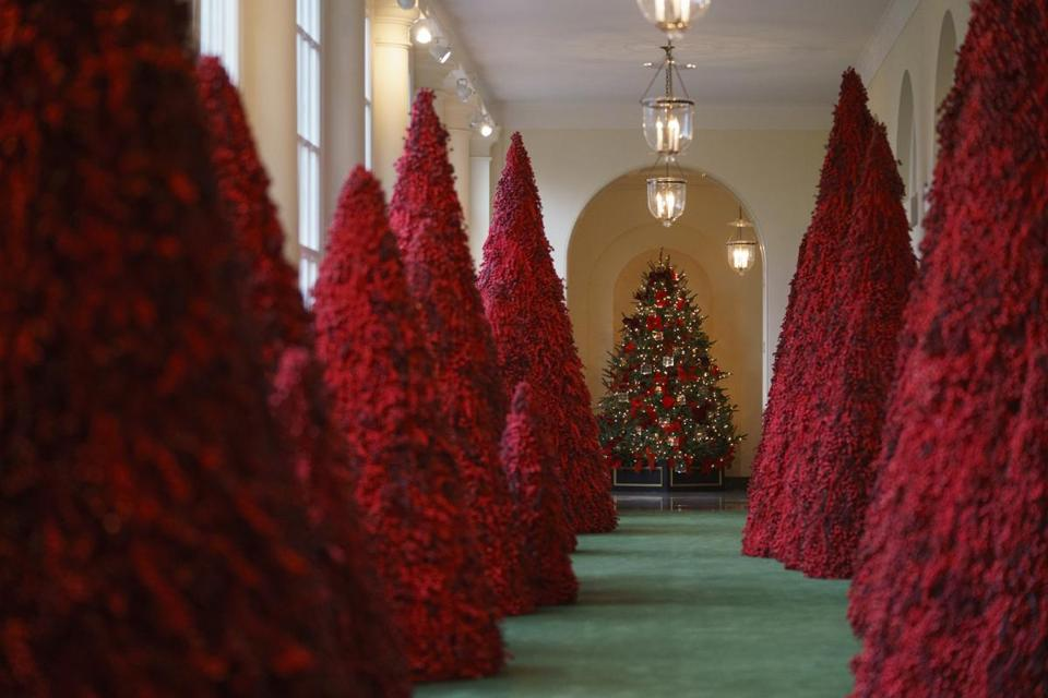 Melania Trump's red topiary trees a hit at Christmas parties