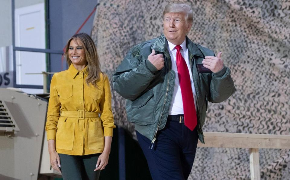 US President Donald Trump and First Lady Melania Trump arrive to speak to members of the US military during an unannounced trip to Al Asad Air Base in Iraq