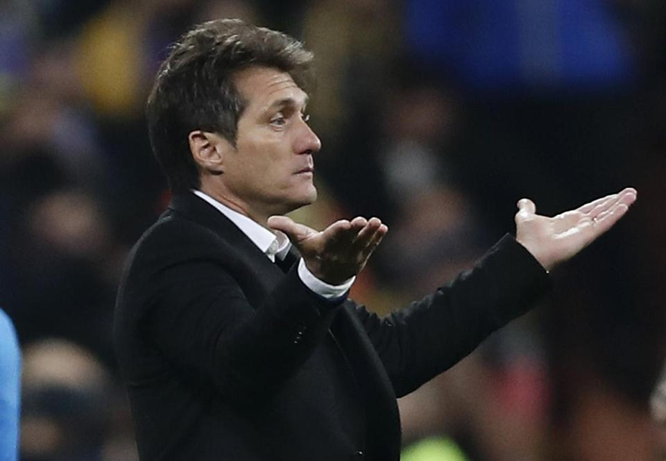 Guillermo Barros Schelotto, coach of Argentina's Boca Juniors, gestures during the Copa Libertadores final soccer match against Argentina's River Plate at the Santiago Bernabeu stadium in Madrid, Spain, Sunday, Dec. 9, 2018. (AP Photo/Manu Fernandez)
