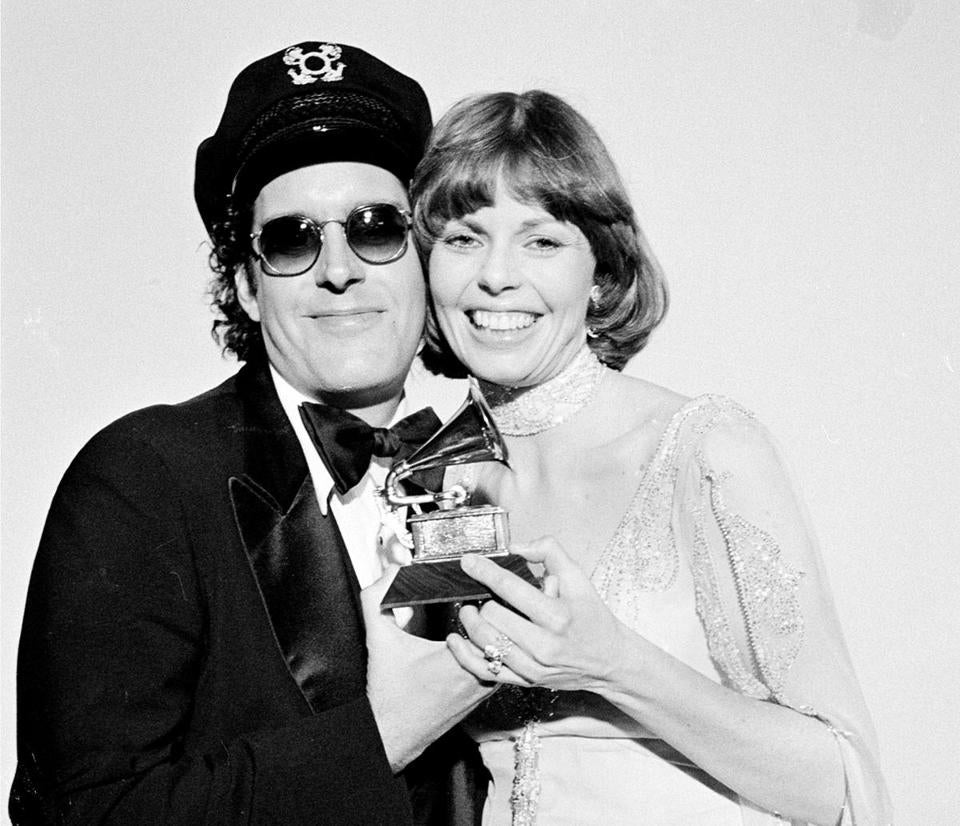 "FILE - In this Feb. 28, 1976 file photo, Daryl Dragon and his wife Toni Tennille, of the Captain & Tennille, hold the Grammy award they won for record of the year for ""Love Will Keep Us Together,"" at the Grammy Awards ceremony in Los Angeles. Dragon died early Wednesday, Jan. 2, 2019 in at a hospice in Prescott, Ariz. Spokesman Harlan Boll said he was 76 and died of renal failure. His former wife and musical partner, Toni Tennille, was by his side. (AP Photo, FIle)"