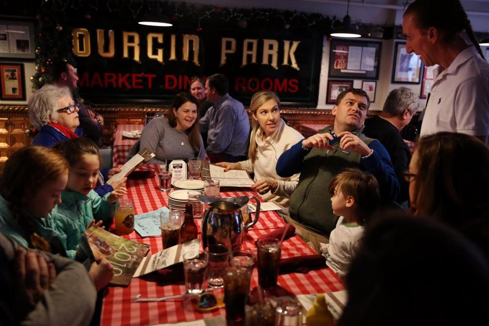 Floor supervisor Frank Cirigliano talked with Kyle Frigon and his family at Durgin-Park in Boston on Jan. 4. The restaurant is slated to close Jan. 12.