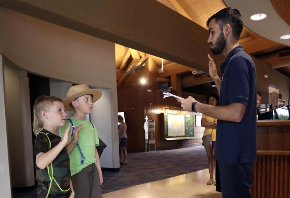 Orion and Theo Simpson are sworn in as junior rangers by Dany Garcia right inside the Ernest F. Coe visitor Center in Everglades National Park Friday Jan. 4 2019 in Homestead Fla. Garcia is being paid by the Florida National Parks Association to