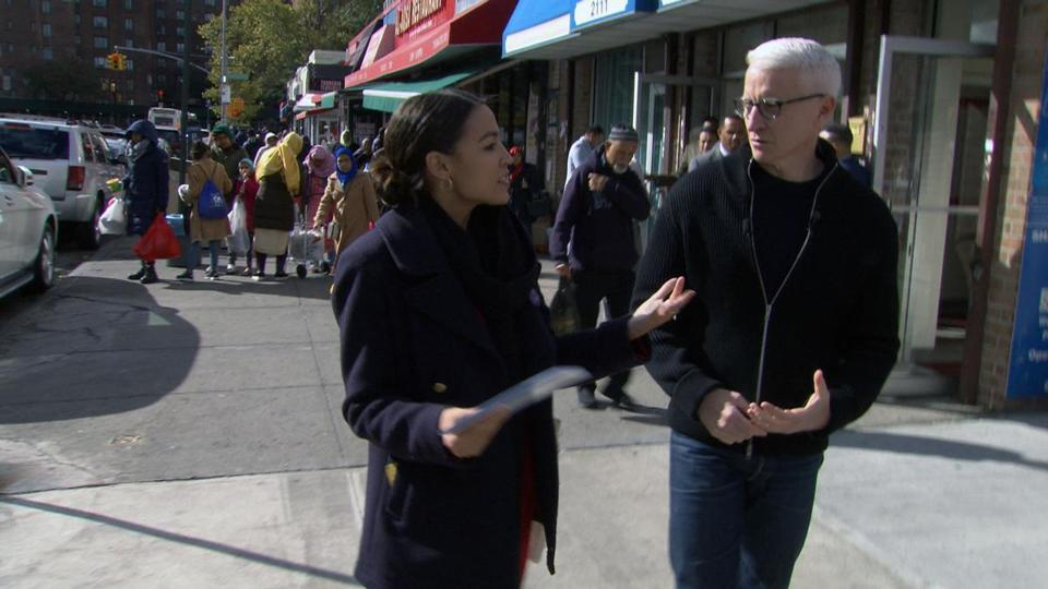 "Alexandria Ocasio-Cotrez and Anderson Cooper in a ""60 Minutes"" segment that aired Sunday night."