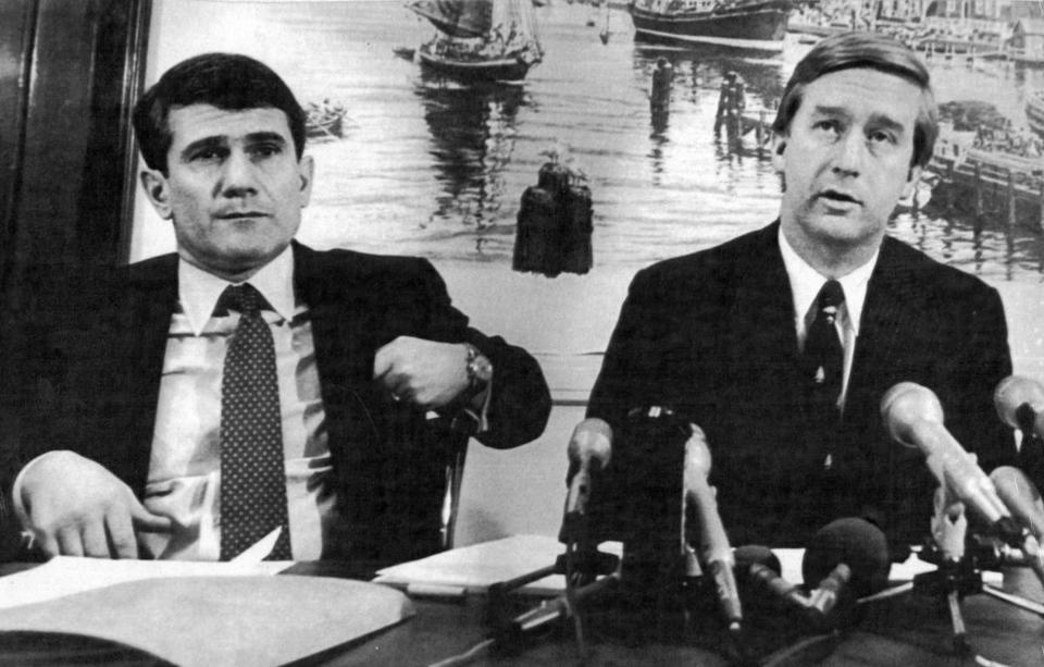 Boston, MA - 1/31/1985: U.S. Attorney William Weld, right, announces a federal lawsuit aimed at spurring the $2 billion cleanup of the pollution in the Boston Harbor during a press conference in Boston on Jan. 31, 1985. New England regional administrator of the Environmental Protection Agency Michael R. Deland looks on at left. (UPI/Wire Photo) --- BGPA Reference: 190109_BS_021