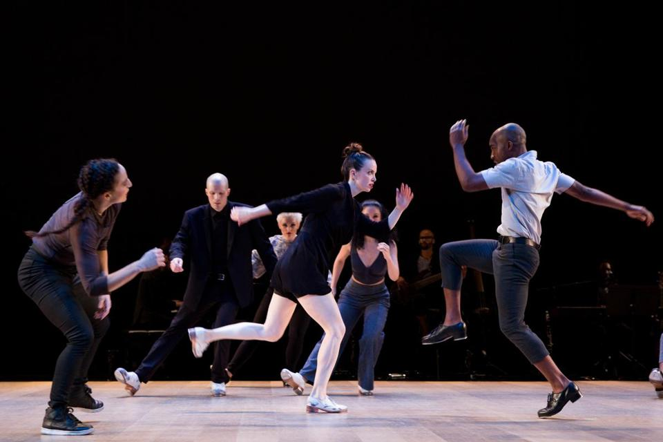 Dancers Michelle Dorrance and Byron Tittle, in foreground,