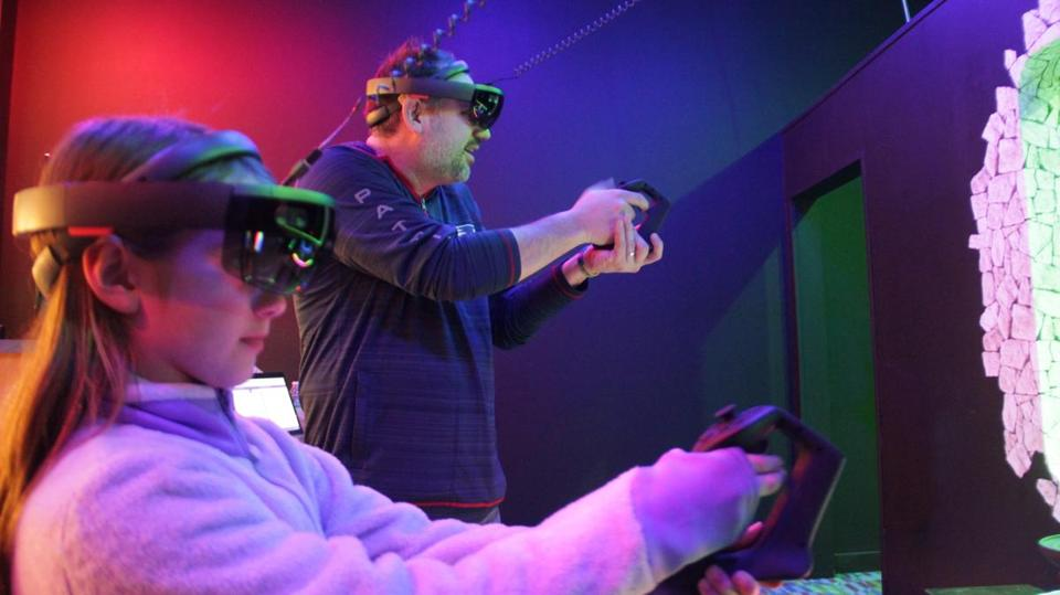 20soinformer -- Rich and Sophie Lyons fend off hordes of the virtual undead at Reality Zombies. (Reality Zombies)