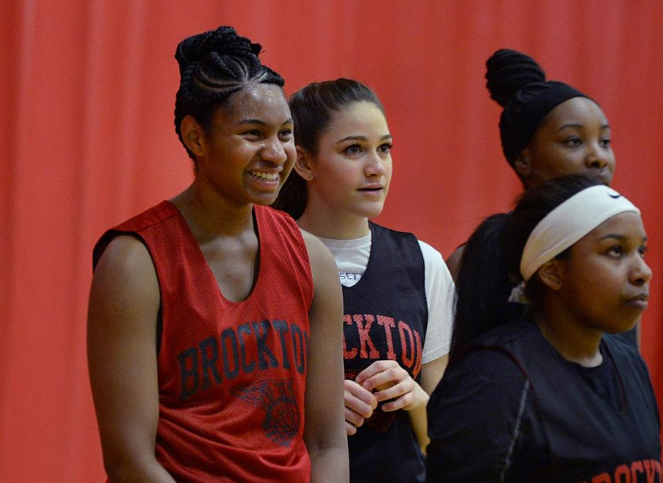 Brockton-01/09/19- Brockton High school girls' basketball players , (l-r) Senior captain Jade Wint and Freshman Alexandra Williams watch as teammates take shots during practice. Photo for the Boston Globe by Debee Tlumacki (sports)