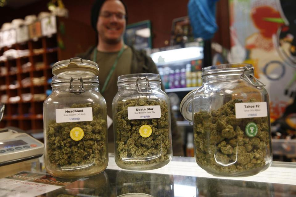 FILE - In this Nov. 27, 2015, file photo, jars of marijuana buds sit on the counter at the Denver Kush Club in north Denver. A simplified program will make it easier for thousands of people to seek the elimination of low-level marijuana convictions that occurred in Denver before recreational use became legal in Colorado, officials said Wednesday, Jan. 9, 2019. (AP Photo/David Zalubowski)