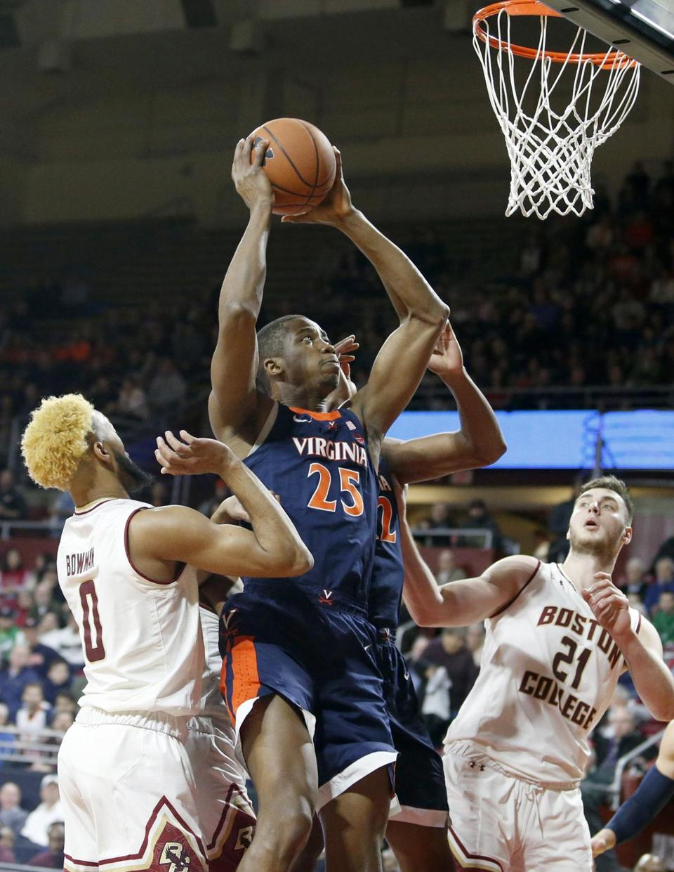 Virginia forward Mamadi Diakite (25) drives to the basket against Boston College for two of his 18 points in Wednesday night's ACC triumph at Chestnut Hill.