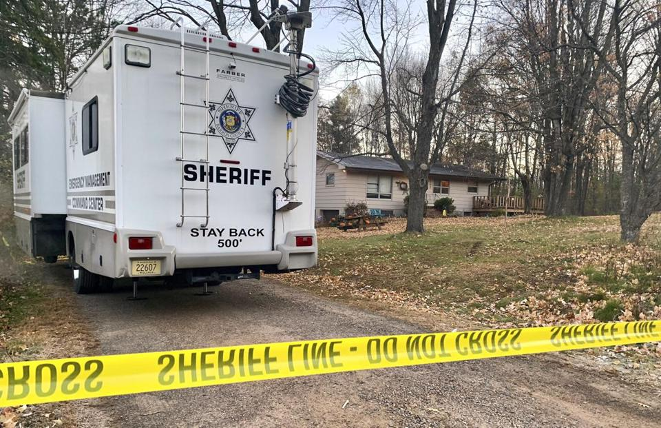 A Barron County, Wis., sheriff's vehicle is parked outside the home where James Closs and Denise Closs were found fatally shot on Oct. 15.