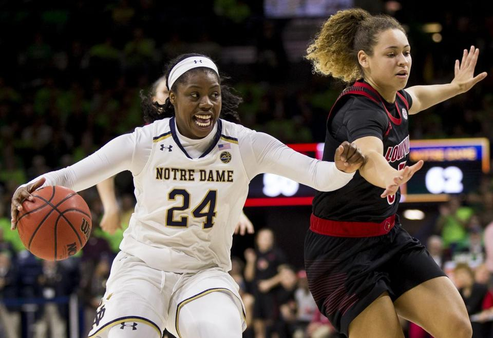 Notre Dame's Arike Ogunbowale (24) drives by Louisville's Mykasa Robinson (5) during the second half of an NCAA college basketball game Thursday, Jan. 10, 2019, in South Bend, Ind. Notre Dame won 82-68. (AP Photo/Robert Franklin)