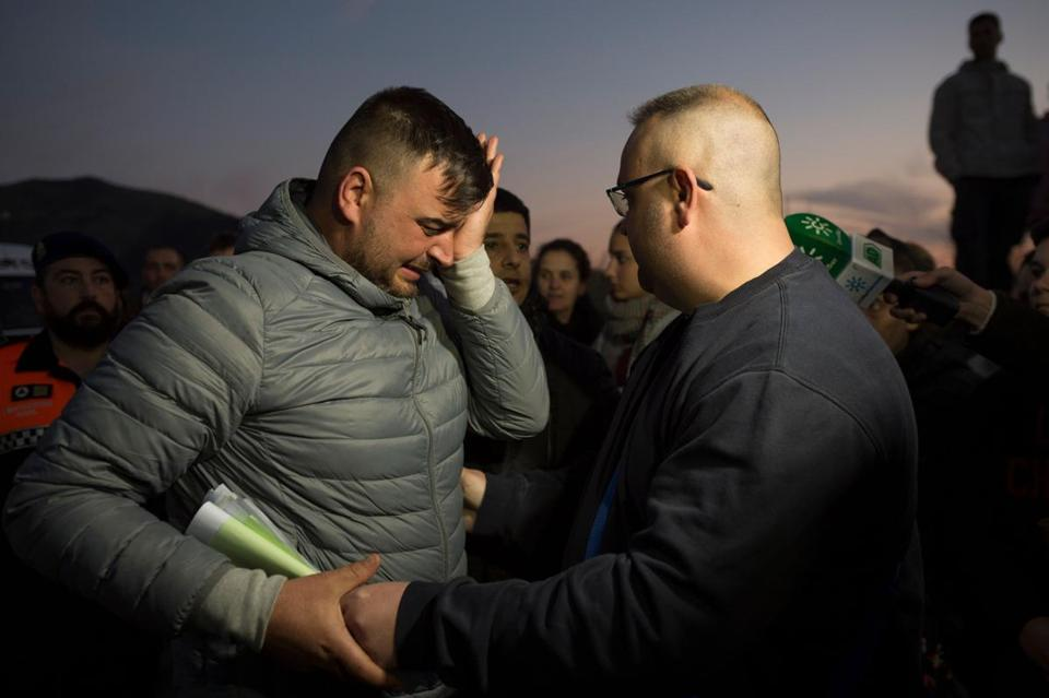 Jose Rosello (left), father of Julen Rosello, 2, who fell down a well, cried as rescue efforts to find the boy continued in Totalan in southern Spain on Wednesday.