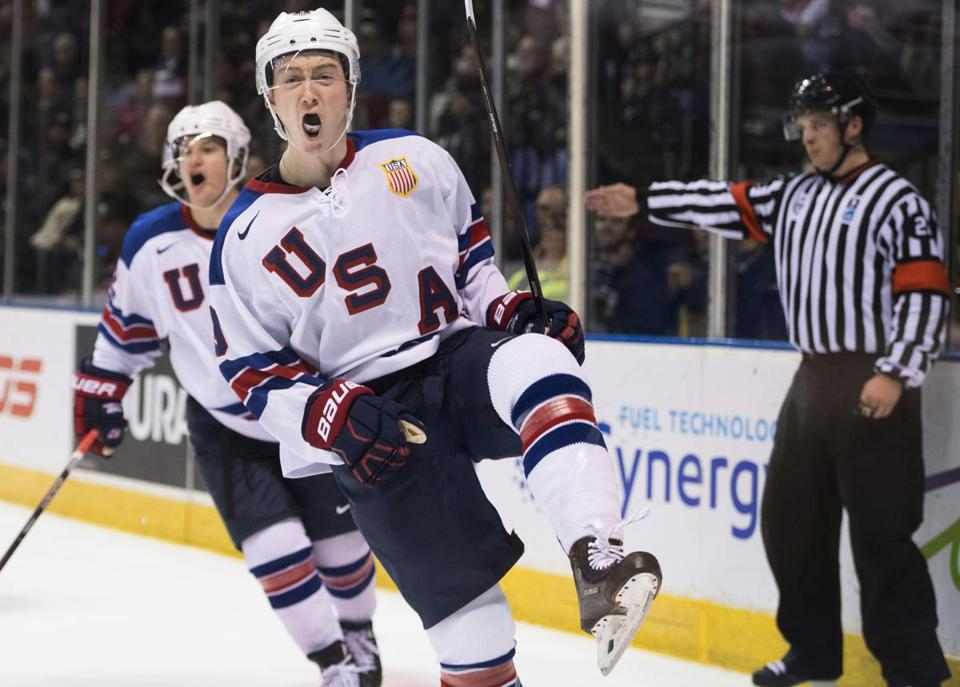 United States' Tyler Madden (9) celebrates his goal against Finland during the second period of a world junior hockey championships game in Victoria, British Columbia, Monday, Dec. 31, 2018. (Jonathan Hayward/The Canadian Press via AP)