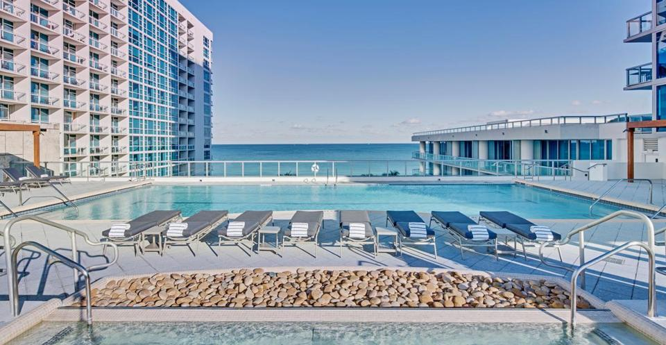 Plan a spa day or treatment at the Carillon Miami Wellness Resort, and enjoy the facilities — including this infinity-edge pool.