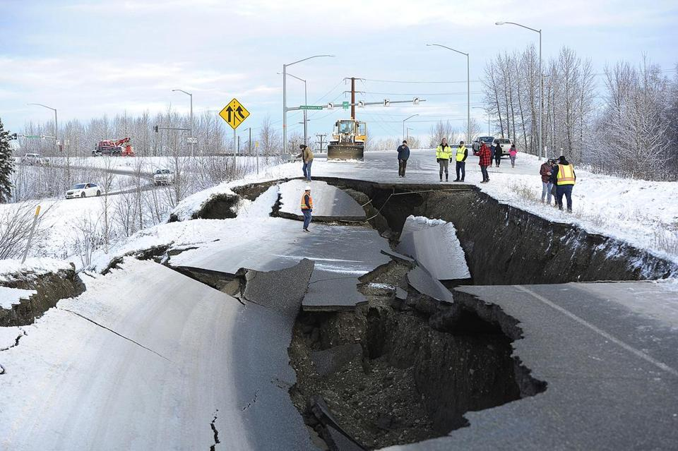 Workers inspected an off-ramp that collapsed during the November earthquake in Anchorage.