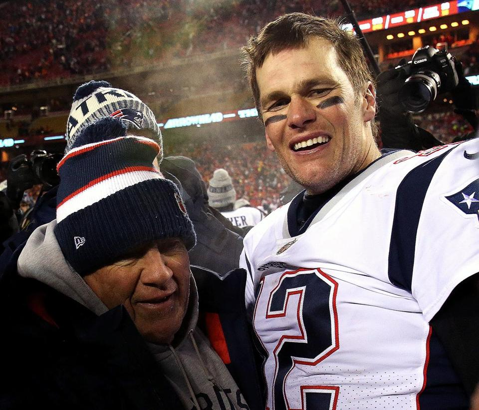 Kansas City, MO - 1/20/2019 - (overtime) New England Patriots head coach Bill Belichick and New England Patriots quarterback Tom Brady (12) celebrate the overtime win over the Kansas City Chiefs. The Kansas City Chiefs host the New England Patriots in the AFC Championship game at Arrowhead stadium. - (Barry Chin/Globe Staff), Section: Sports, Reporter: James M. McBride, Topic: 21Patriots-Chiefs, LOID: 8.5.157043654.