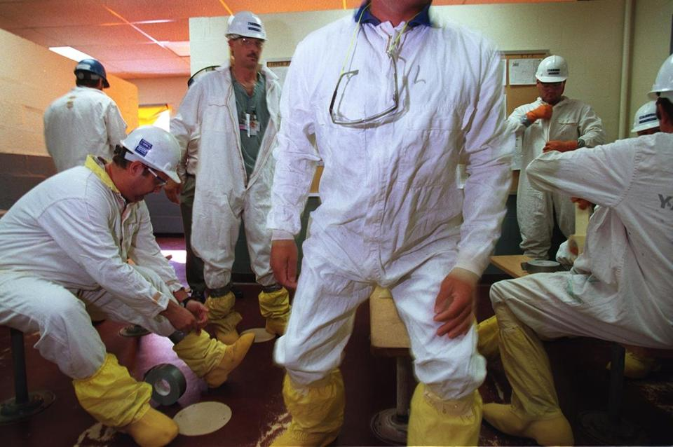 Rowe, MA - Workers at the Yankee Rowe Atomic plant don protective clothing before entering the nuclear area as part of decommisioning work. Much of the work is subcontracted. Staff photo by Mark Wilson. Nuclear Twilight in New England