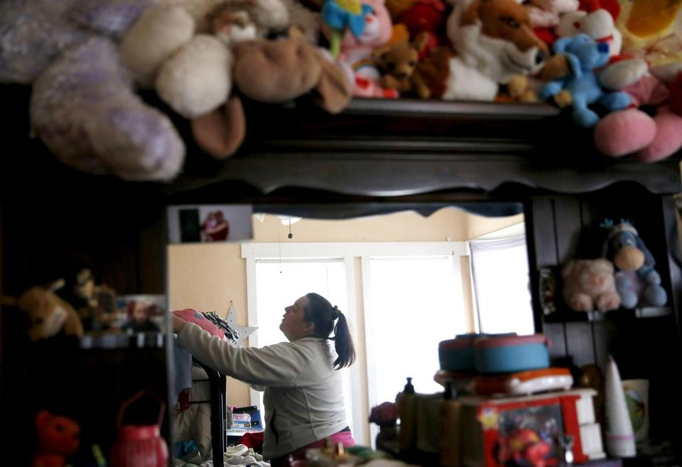 Cynthia cleaned her children's room before a visit from a Department of Children and Families worker at her home.