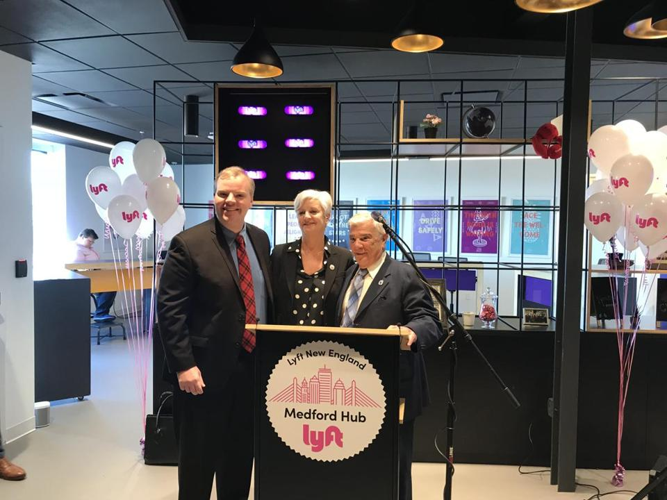 27zobriefsphotos -- From left, State Representative Sean Garballey, Mayor Stephanie M. Burke, and state Representative Paul Donato at the new Lyft Hub in Medford. (Allie Fiske/City of Medford)