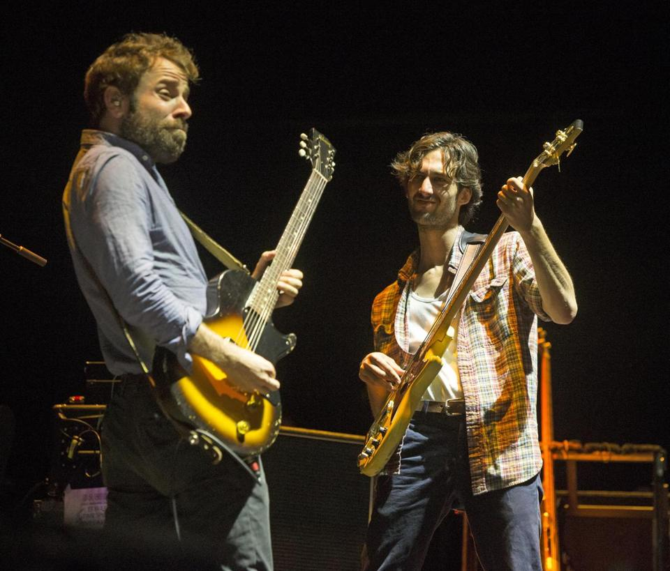 "Taylor Goldsmith, left, and Wylie Gelber of the band Dawes perform in concert as the opening act for John Mayer during his ""The Search for Everything Tour"" at The BB&T Pavilion on Friday, Aug. 18, 2017, in Camden, N.J. (Photo by Owen Sweeney/Invision/AP)"
