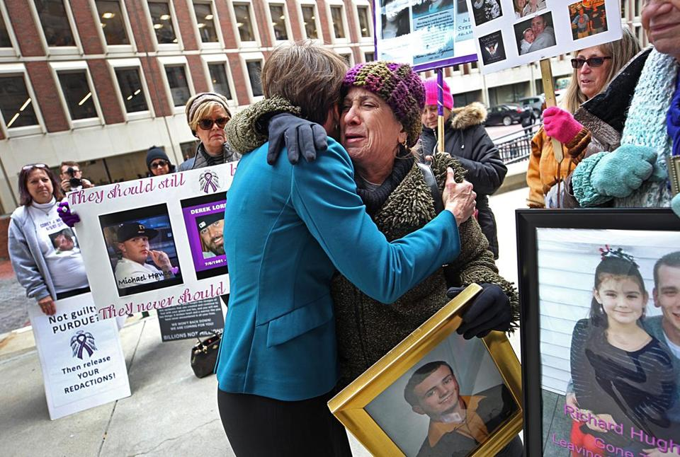 Attorney General Maura Healey (left) embraced Paula Haddad, whose son Jordan died from opioids.